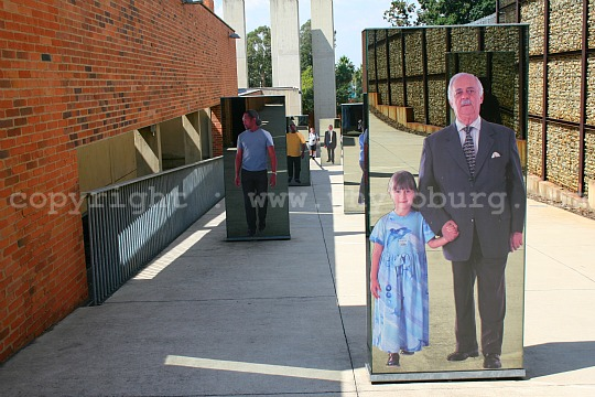 Once through the entrance turnstiles, you share the ramp leading to the entrance of the Apartheid Museum, with life size photos of some of the residents of Johannesburg, with their children, grandchildren and great-grandchildren.