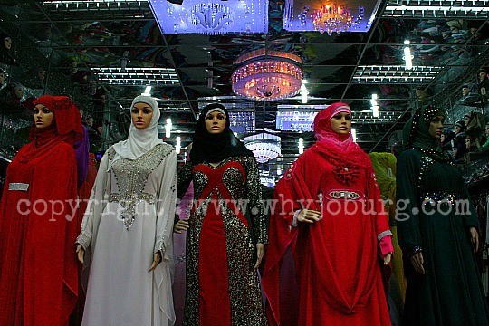 Brightly coloured abayas on sale in one of the many shops in Fordsburg selling Muslim clothing.