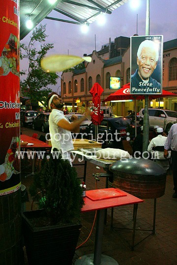 A laffa bread made outside the 'House of Schwarma' in Fordsburg, Johannesburg, watched approvingly by Nelson Mandela!