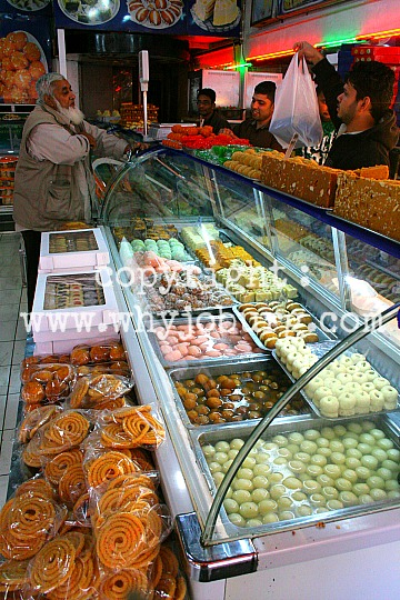 A fridge full of very sweet, and very decadent Indian sweetmeats in Shaheen Sweets and Bakers