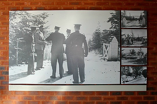 The police outside the entrance gate to Liliesleaf Farm in Rivonia, Johannesburg, during their raid on the ANC on Thursday 11th July 1963.