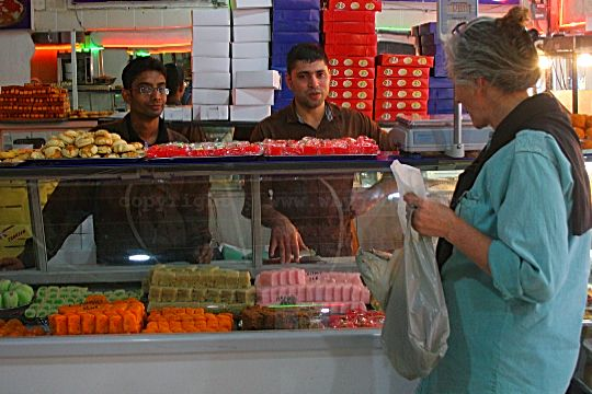 Buying Indian Sweetmeats at Shaheen Sweets in Fordsburg.