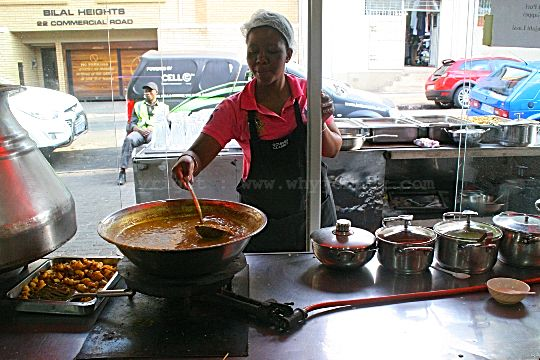 Street food being sold through an open shop window in Fordsburg!