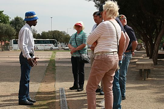 Poloko, a well known site guide at the Hector Pieterson Memorial, explains the 1976 student uprisings to his European guests