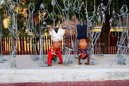 """Children use the Uprisings Sculpture called """"Student Confrontation"""" by Stone Mabubda, on the Hector Pieterson Trail at the corner of Moema and Vilakazi Streets, as a jungle gym!"""