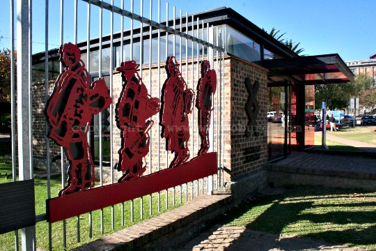 The entrance to the Johannesburg Workers Museum with cutout figures of migrant workers