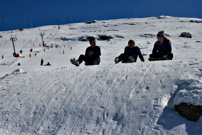 A family starting a run on their bumboards at the Afriski Mountain Lodge in Lesotho