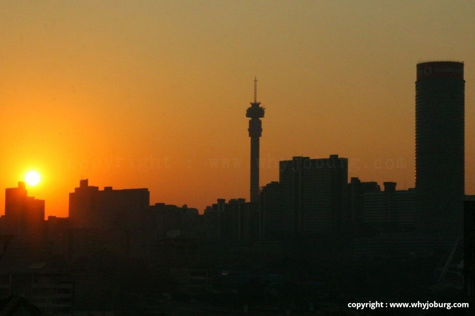 The Johannesburg syline at sunset, showing the Hillbrow Tower in centre, and Ponte at right.